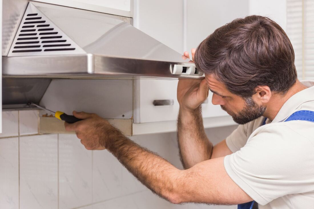 Man fixing an oven