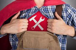 Man opening his shirt in a superhero like fashion revealing a work tools logo